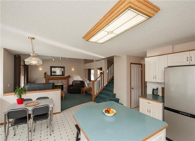 For Sale: 12 West Boothby Crescent, Cochrane, AB | 4 Bed, 3 Bath House for $449,900. See 46 photos!