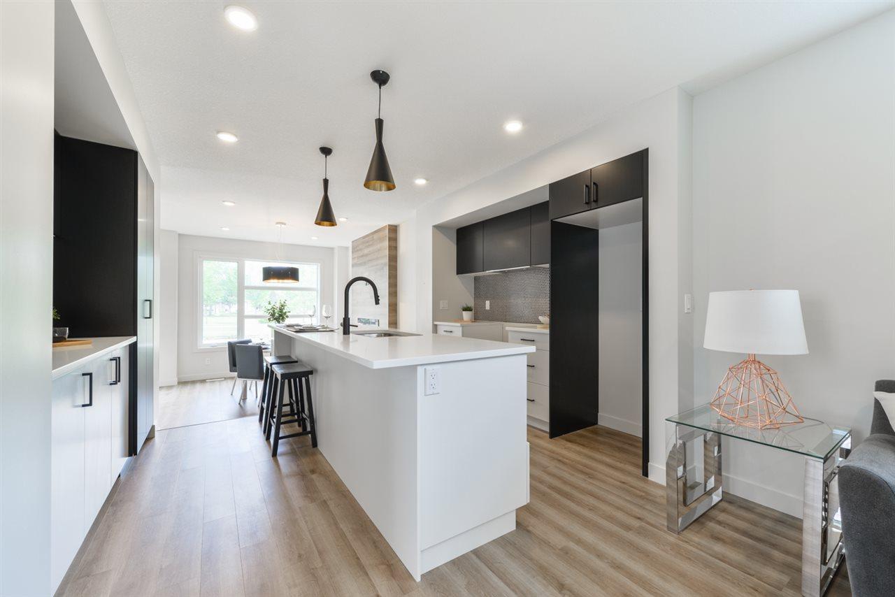 For Sale: 12037 124 Street, Edmonton, AB | 3 Bed, 2 Bath House for $459,900. See 30 photos!