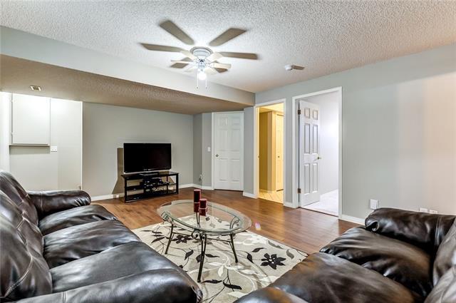 For Sale: 121 Saratoga Close Northeast, Calgary, AB | 4 Bed, 2 Bath House for $399,900. See 24 photos!