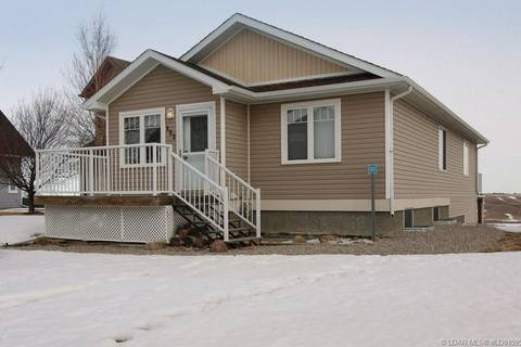 Home for sale at 122 White Pelican Wy Vulcan Alberta - MLS: LD0159537