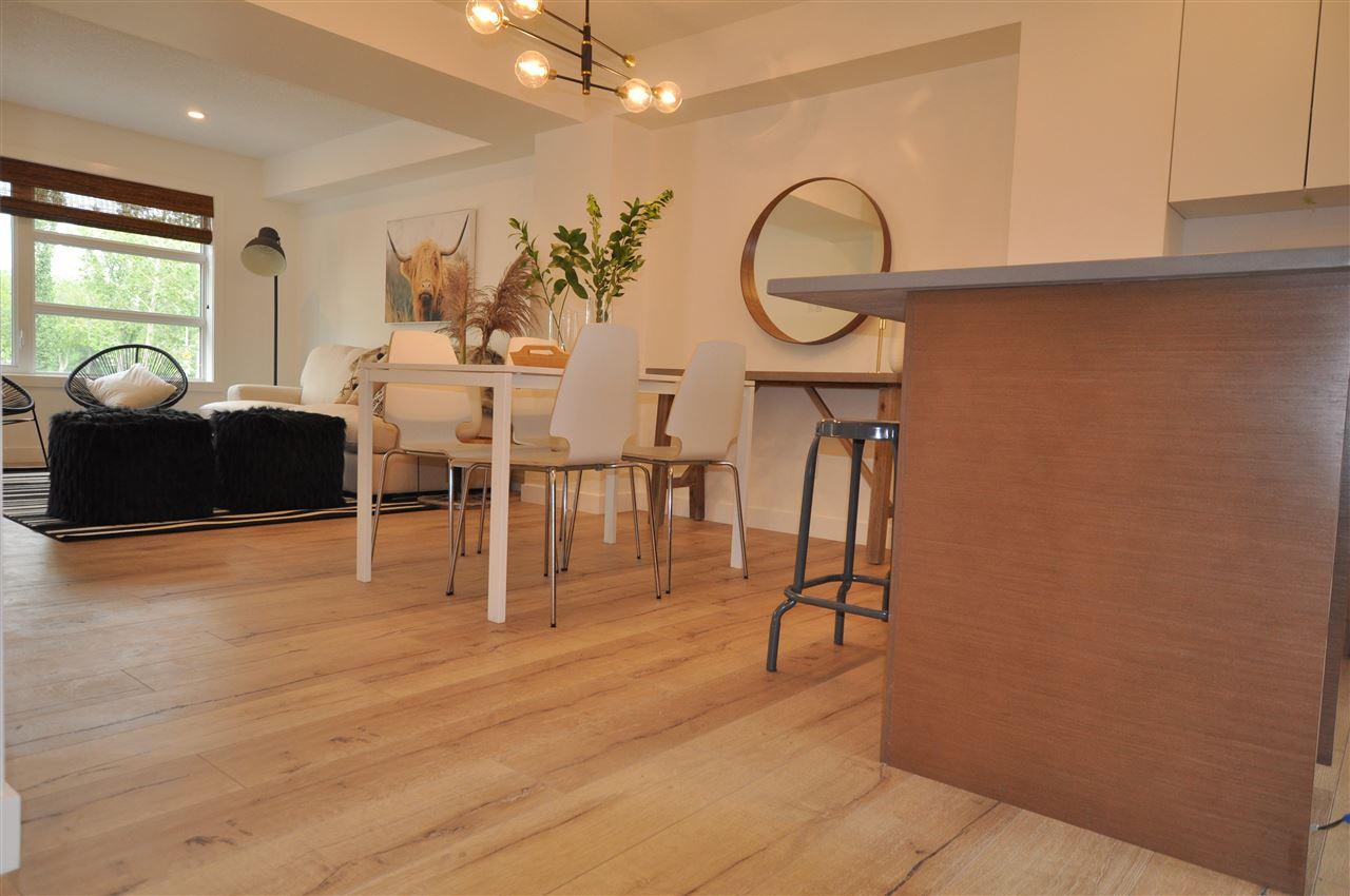 For Sale: 12507 115 Avenue, Edmonton, AB | 3 Bed, 2 Bath Condo for $409,900. See 10 photos!