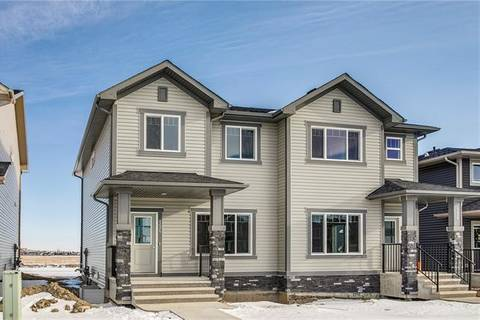 Townhouse for sale at 126 Heartland Blvd Cochrane Alberta - MLS: C4287410