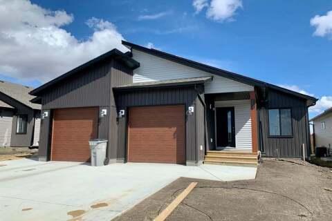 Townhouse for sale at 12633 102a St Grande Prairie Alberta - MLS: GP213400