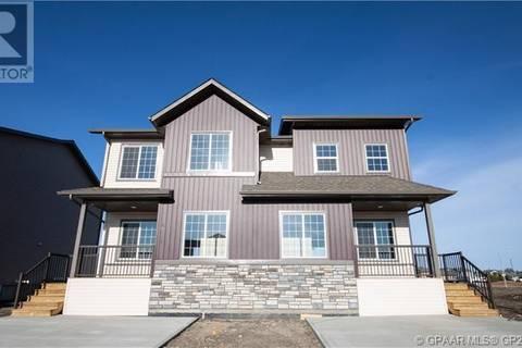 Townhouse for sale at 12718 103b St Unit 12722 Grande Prairie Alberta - MLS: GP205643