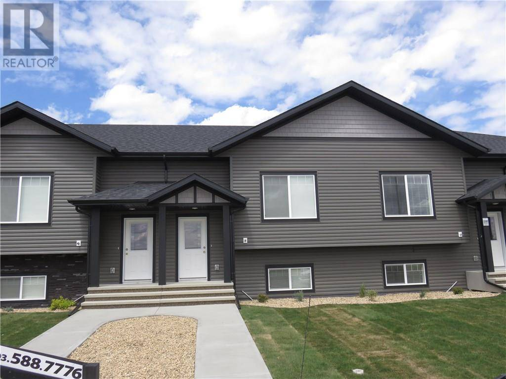 Townhouse for sale at 128 Mackenzie Ranch Wy Lacombe Alberta - MLS: ca0183266