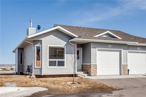 Townhouse for sale at 128 Ridgestone Ln Southwest Black Diamond Alberta - MLS: C4293424