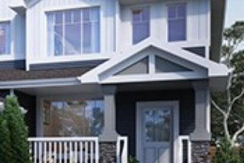Townhouse for sale at 129 Heartland Street  Cochrane Alberta - MLS: A1034118