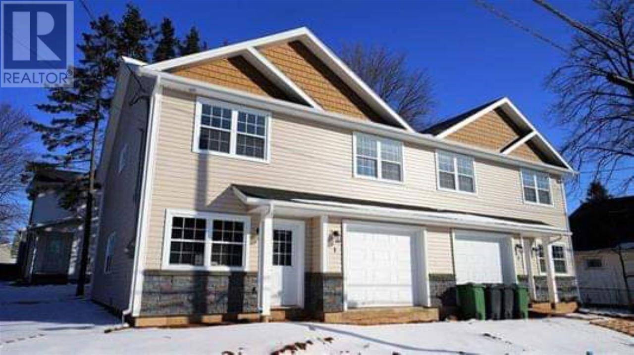 Townhouse for sale at  Summer St Unit 1&3 Charlottetown Prince Edward Island - MLS: 202004554