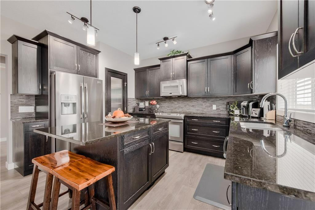 For Sale: 133 Wildrose Crescent, Strathmore, AB | 3 Bed, 2 Bath House for $520,000. See 2 photos!
