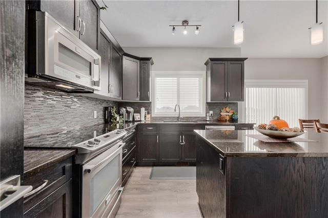 For Sale: 133 Wildrose Crescent, Strathmore, AB | 3 Bed, 2 Bath House for $490,000. See 29 photos!