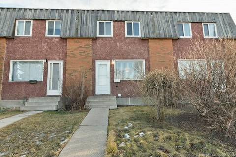 Townhouse for sale at 1411 Lakemount Blvd S Lethbridge Alberta - MLS: LD0172250