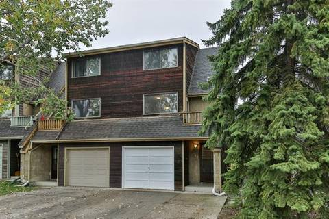 Townhouse for sale at 1414 Ranchlands Rd Northwest Calgary Alberta - MLS: C4279183