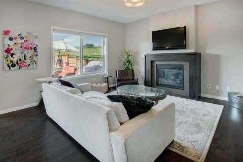 Townhouse for sale at 143 Fireside Cove Cochrane Alberta - MLS: A1017996
