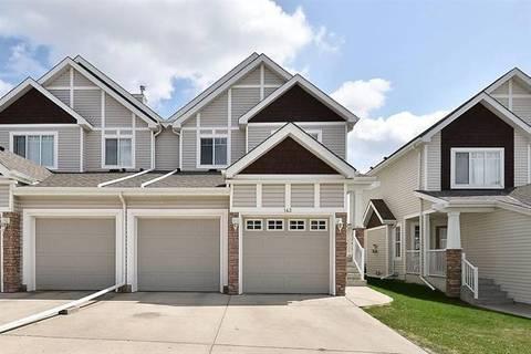 Townhouse for sale at 143 Hidden Creek Gdns Northwest Calgary Alberta - MLS: C4244786