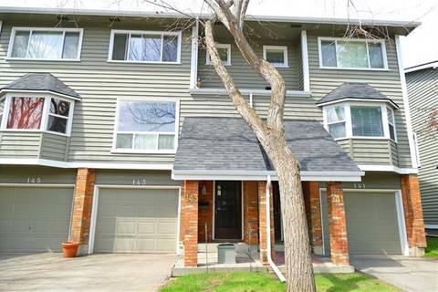 Townhouse for sale at 143 Woodglen Gr Southwest Calgary Alberta - MLS: C4242026