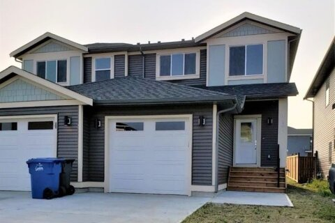 Townhouse for sale at 1431 Aldrich Pl Carstairs Alberta - MLS: A1035036