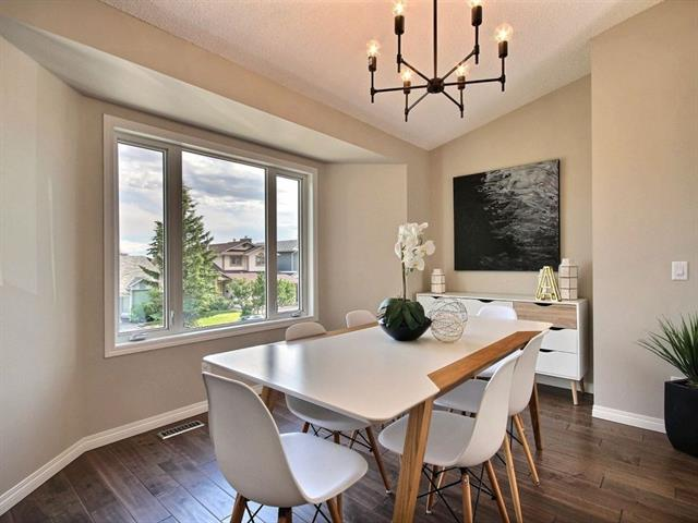 For Sale: 145 Hawkdale Close Northwest, Calgary, AB | 4 Bed, 2 Bath House for $639,900. See 19 photos!