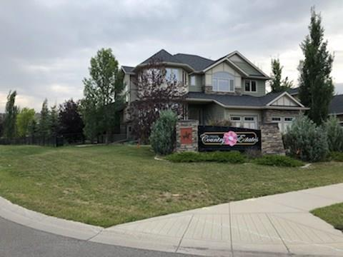 For Sale: 148 Cimarron Drive, Okotoks, AB | 5 Bed, 3 Bath House for $684,900. See 19 photos!