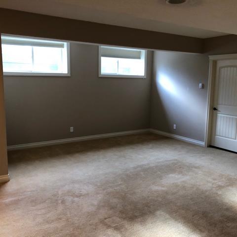 For Sale: 148 Cimarron Drive, Okotoks, AB   5 Bed, 3 Bath House for $684,900. See 19 photos!