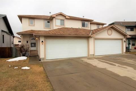 Townhouse for sale at 150 Quigley Cs Cochrane Alberta - MLS: C4243594