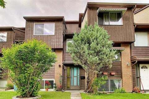 Townhouse for sale at 1516 Ranchlands Wy Northwest Calgary Alberta - MLS: C4302550
