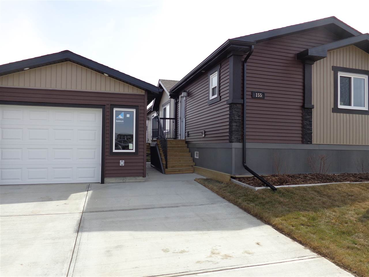 For Sale: 155 Aspen Avenue, Morinville, AB | 3 Bed, 2 Bath Home for $251,731. See 22 photos!