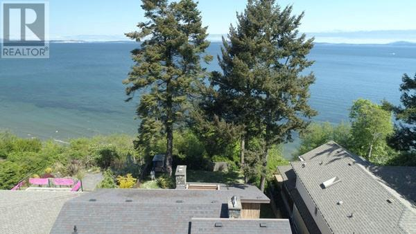 For Sale: 1550 Mileva Lane, Victoria, BC | 6 Bed, 3 Bath House for $1,885,000. See 16 photos!
