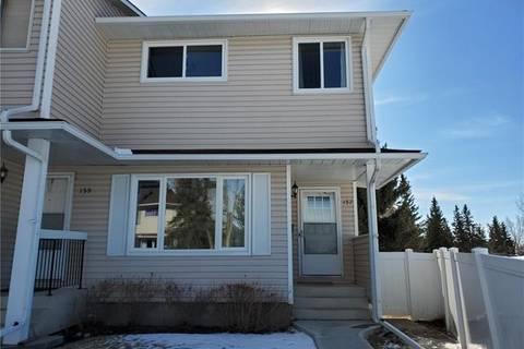 Townhouse for sale at 157 Woodsman Ln Southwest Calgary Alberta - MLS: C4288043