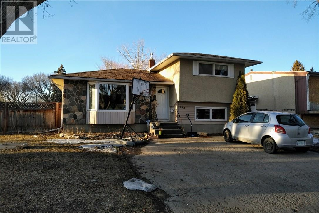 For Sale: 160 Cooper Crescent, Regina, SK | 4 Bed, 2 Bath House for $245,000. See 3 photos!