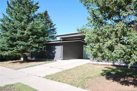 House for sale at 1606 Lakemount Blvd S Lethbridge Alberta - MLS: LD0175842
