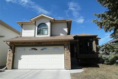 House for sale at 17151 Sundown Rd Southeast Calgary Alberta - MLS: C4228894