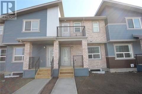 Townhouse for sale at 1741 Red Spring St Regina Saskatchewan - MLS: SK790023