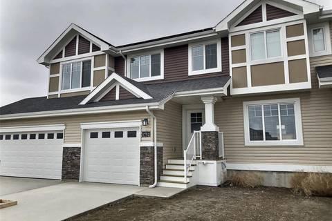 Townhouse for sale at 1752 Mustard St Regina Saskatchewan - MLS: SK770299