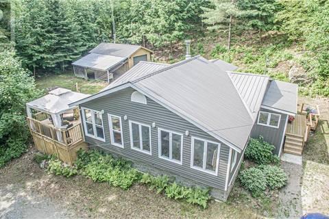 House for sale at 1753 Kamaniskeg Lake Rd Combermere Ontario - MLS: 202311