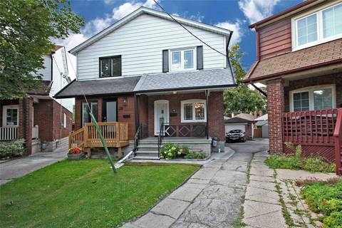 Townhouse for sale at 18 Falwyn Ave Toronto Ontario - MLS: C4575332