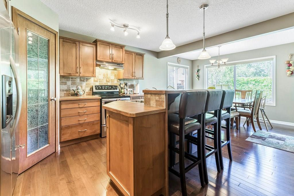 For Sale: 183 New Brighton Drive Southeast, Calgary, AB | 3 Bed, 2 Bath House for $424,900. See 32 photos!