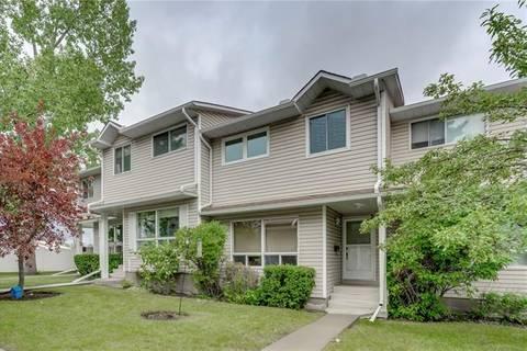 Townhouse for sale at 185 Woodsman Ln Southwest Calgary Alberta - MLS: C4263303