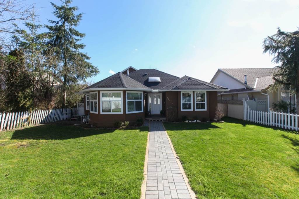 For Sale: 18524 64 Avenue, Surrey, BC | 4 Bed, 4 Bath House for $1,049,000. See 20 photos!