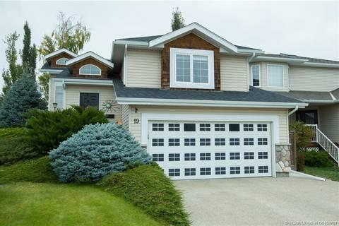 House for sale at 19 Fairmont Cove S Lethbridge Alberta - MLS: LD0158767
