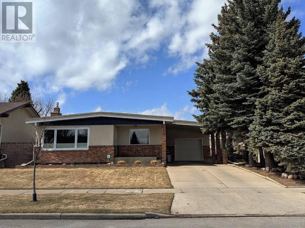 House for sale at 1902 Lakemount Blvd S Lethbridge Alberta - MLS: ld0190953