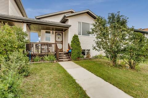 Townhouse for sale at 1922 29 Ave Nanton Alberta - MLS: C4283419