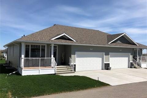 Townhouse for sale at 195 Ridgestone Ln Black Diamond Alberta - MLS: C4235497