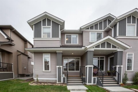 Townhouse for sale at 196 Willow St Cochrane Alberta - MLS: A1034773