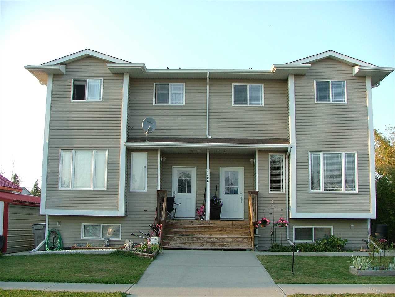 For Sale: 4708 49 Avenue, Calmar, AB | 3 Bed, 2 Bath Townhouse for $199,000. See 17 photos!