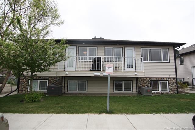 For Sale: 541 9 Avenue North, Lethbridge, AB | 2 Bed, 2 Bath Townhouse for $167,900. See 23 photos!