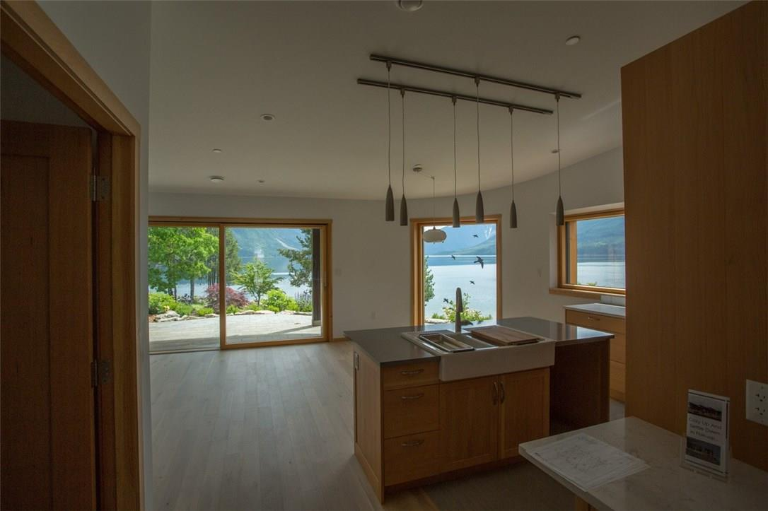 For Sale: 95 7th Avenue Southwest, Nakusp, BC | 2 Bed, 3 Bath House for $799,000. See 13 photos!