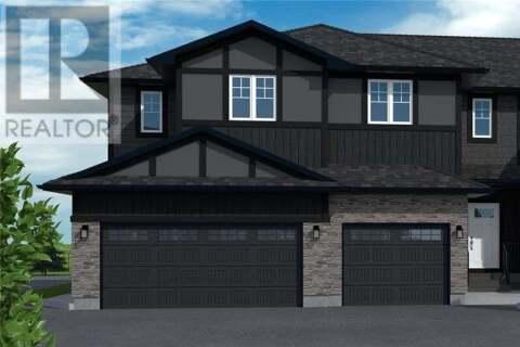 Townhouse for sale at 1003 Evergreen Blvd Unit 20 Saskatoon Saskatchewan - MLS: SK819521