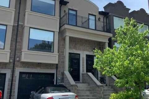 Townhouse for rent at 20 Matthew Ct Toronto Ontario - MLS: W4782249