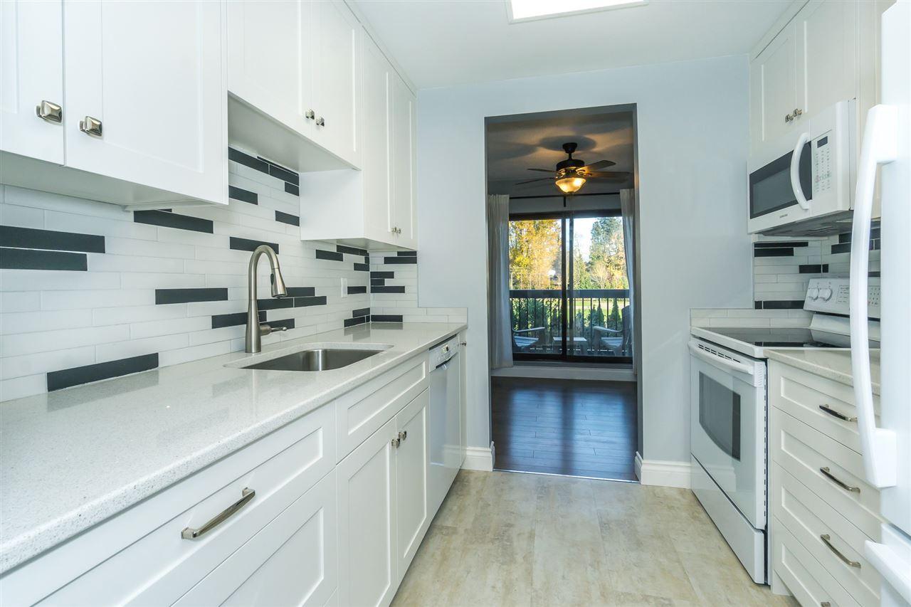 Sold: 202 - 33870 Fern Street, Abbotsford, BC