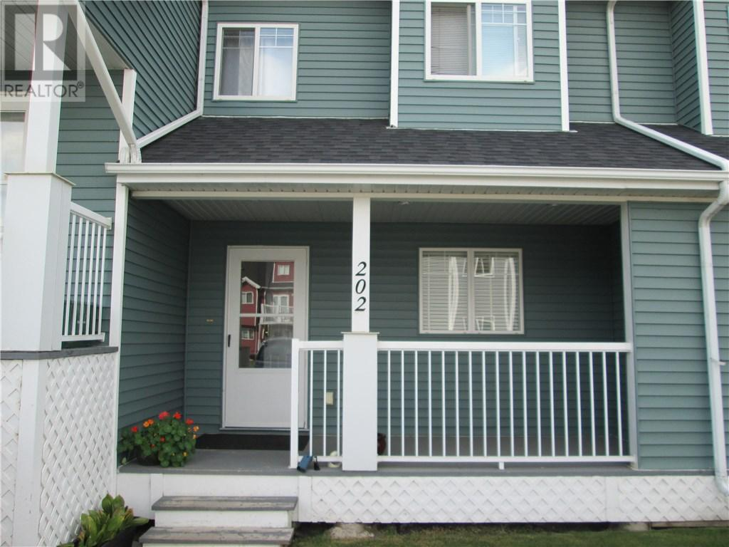 For Sale: 202 - 5220 50a Avenue, Sylvan Lake, AB | 2 Bed, 2 Bath Townhouse for $182,900. See 23 photos!